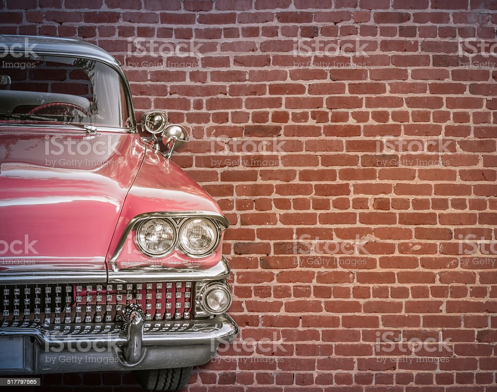 Classic Car Against Red Brick Wall stock photo