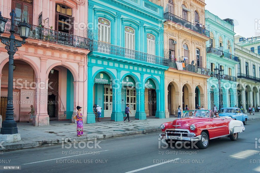 Classic car and colorful colonial buildings in Old Havana, Cuba stock photo