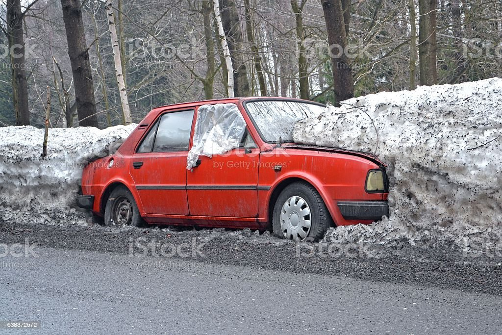 Classic car dying on the road in winter scenery stock photo