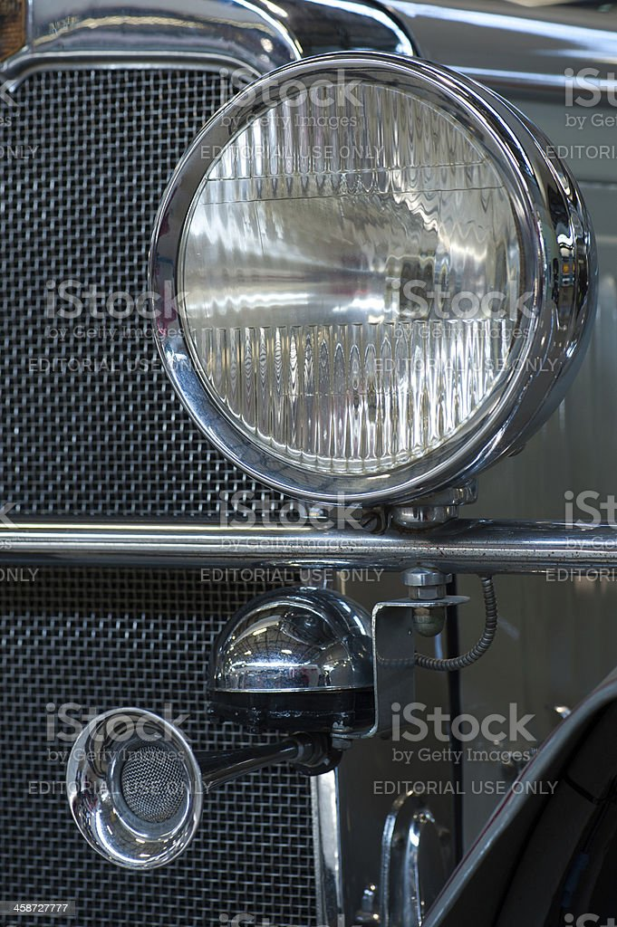 Classic car headlamp and grill stock photo