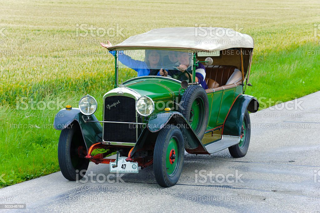 Classic car rally with Peugeot stock photo