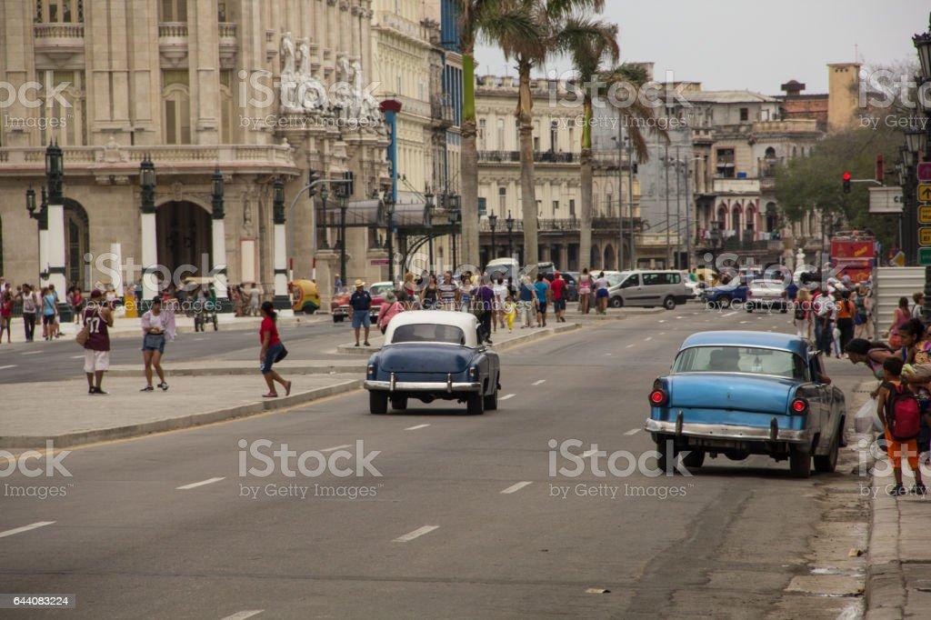 Classic cars driving on Paseo de Martí avenue, Havana stock photo