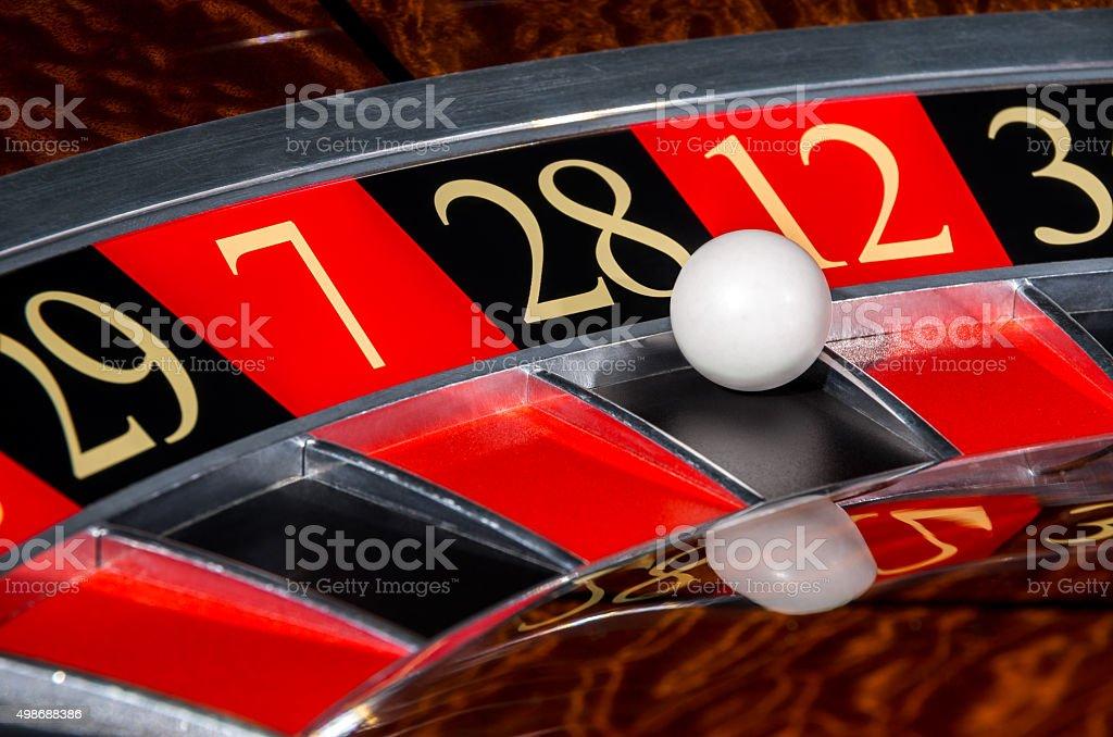 Classic casino roulette wheel with black sector twenty-eight 28 stock photo