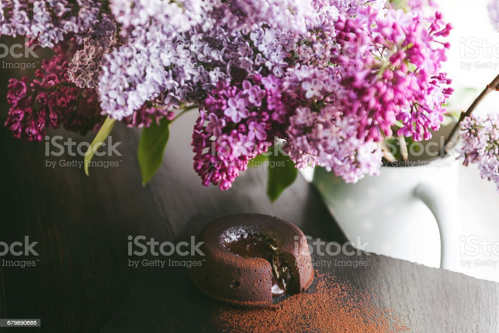 Classic chocolate fondant on a dark background with flowers stock photo