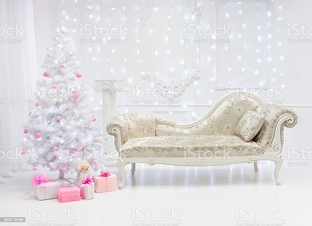 Classic Christmas light interio with couch and white tree stock photo