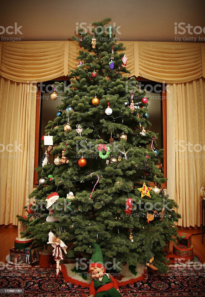 Classic Christmas Tree in Stylish Living Room royalty-free stock photo
