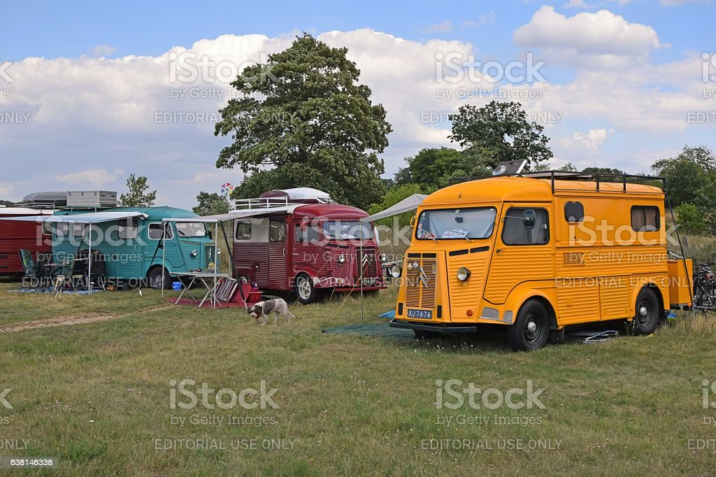 Classic Citroen HY vehicles on the camping stock photo