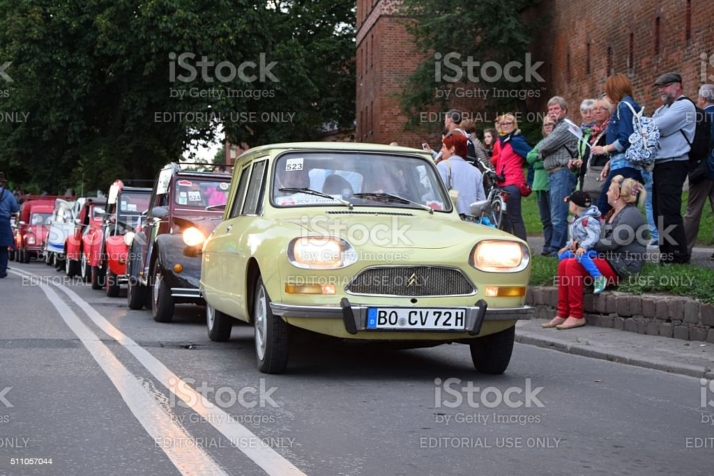 Classic Citroen vehicles driving on the street during the parade stock photo