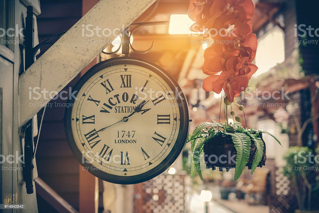 classic clock in the old town background stock photo