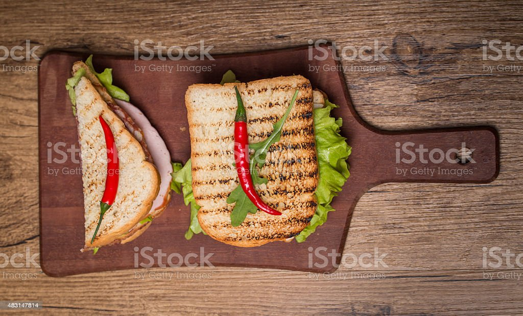 Classic club sandwich with bacon and vegetables stock photo