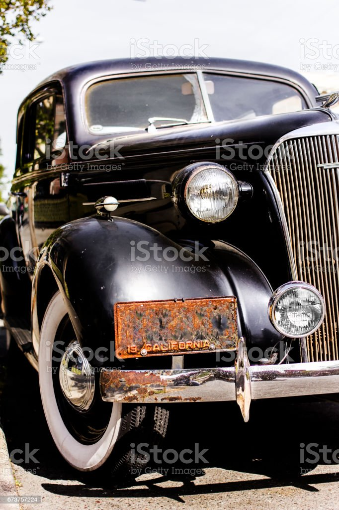 Classic collector's car. Black color chromes and white tires. Mid 1930's. California license plate. stock photo