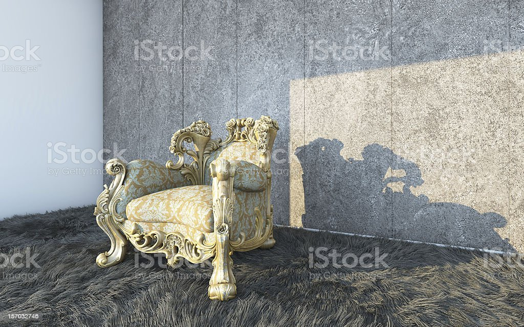 Classic Curved Chair On A Textured Wall royalty-free stock photo