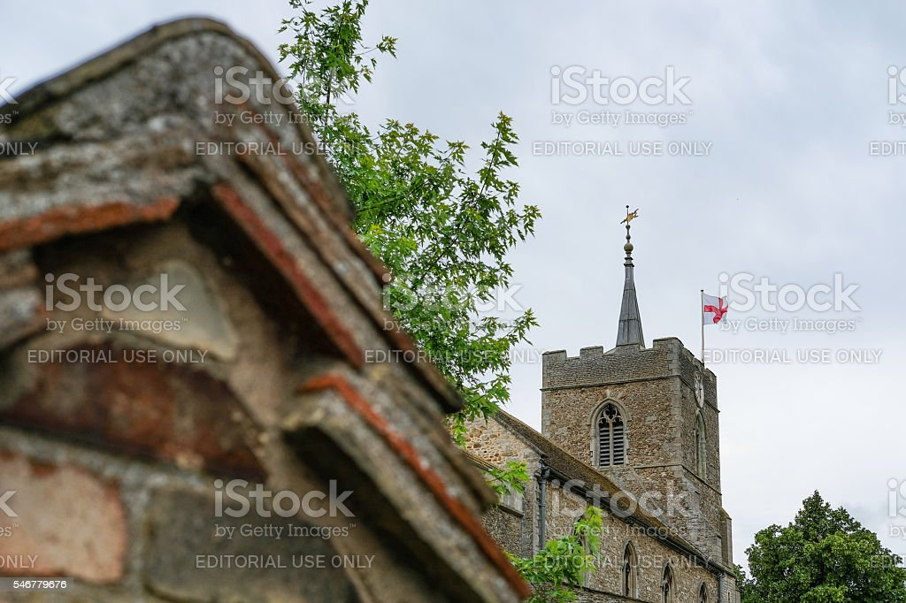 Classic english church building with flag flying stock photo