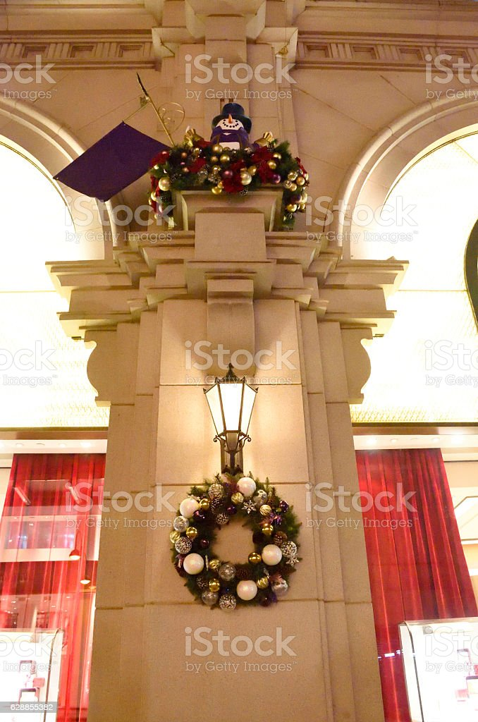 Classic european style building with wall lamp and christmas decoration stock photo