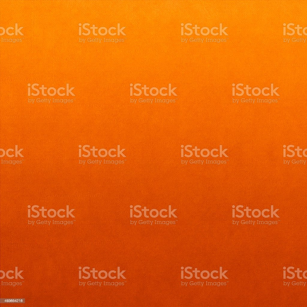 Classic fabric soft textured gradient background in bright orange colour stock photo