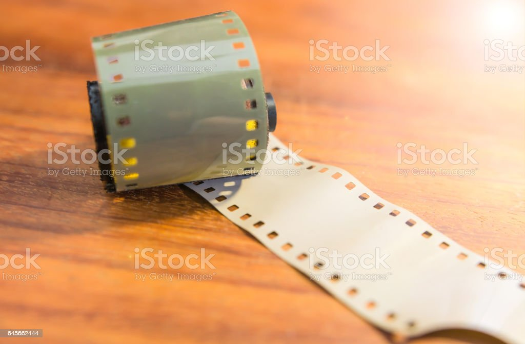 Classic film 35 mm on a wooden table stock photo