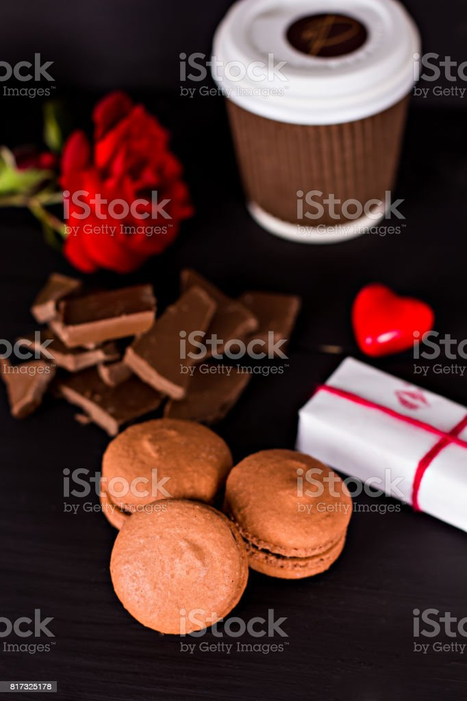 Classic French macaroons on a black background stock photo