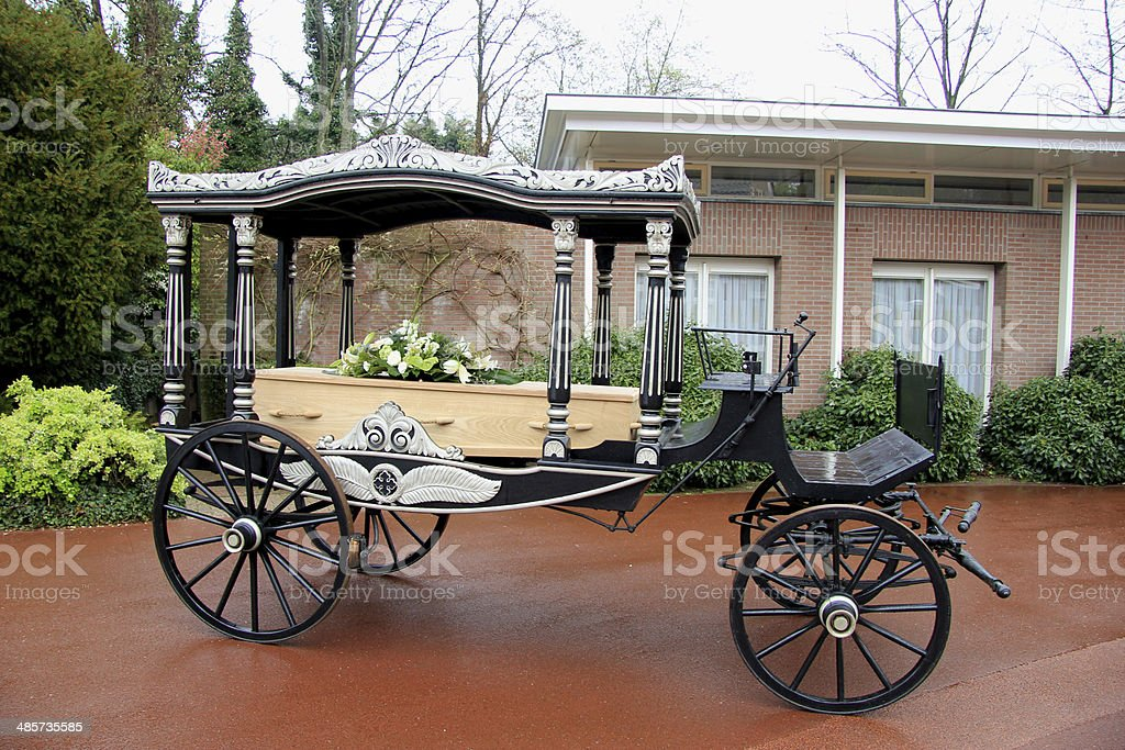 Classic funeral carriage with coffin stock photo