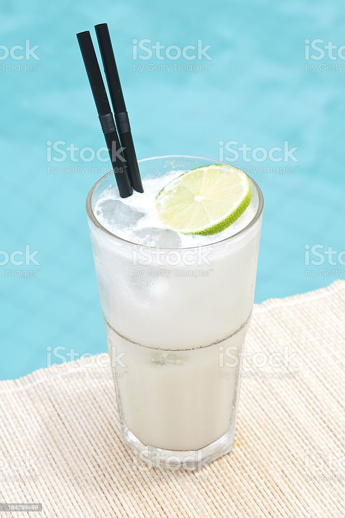 Classic Gin Fizz cocktail near waterpool on the mat stock photo