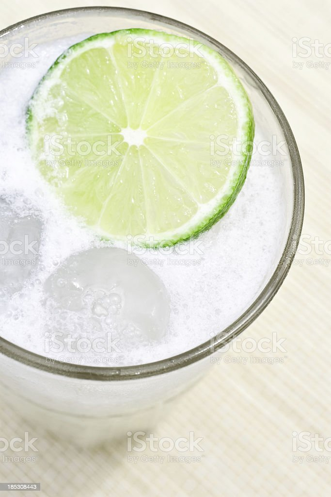 Classic Gin Fizz cocktail on the mat close up royalty-free stock photo