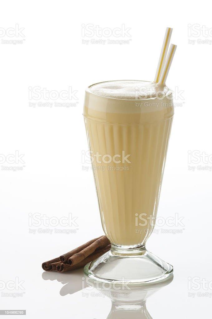 Classic glass of vanilla milkshake on white backdrop. royalty-free stock photo