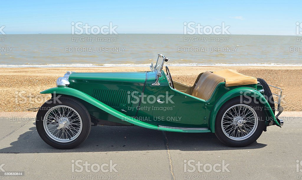 Classic Green MG Sports car parked on seafront promenade. stock photo