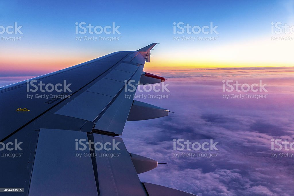 Classic image of wing clouds and wingtip on comercial airplane stock photo