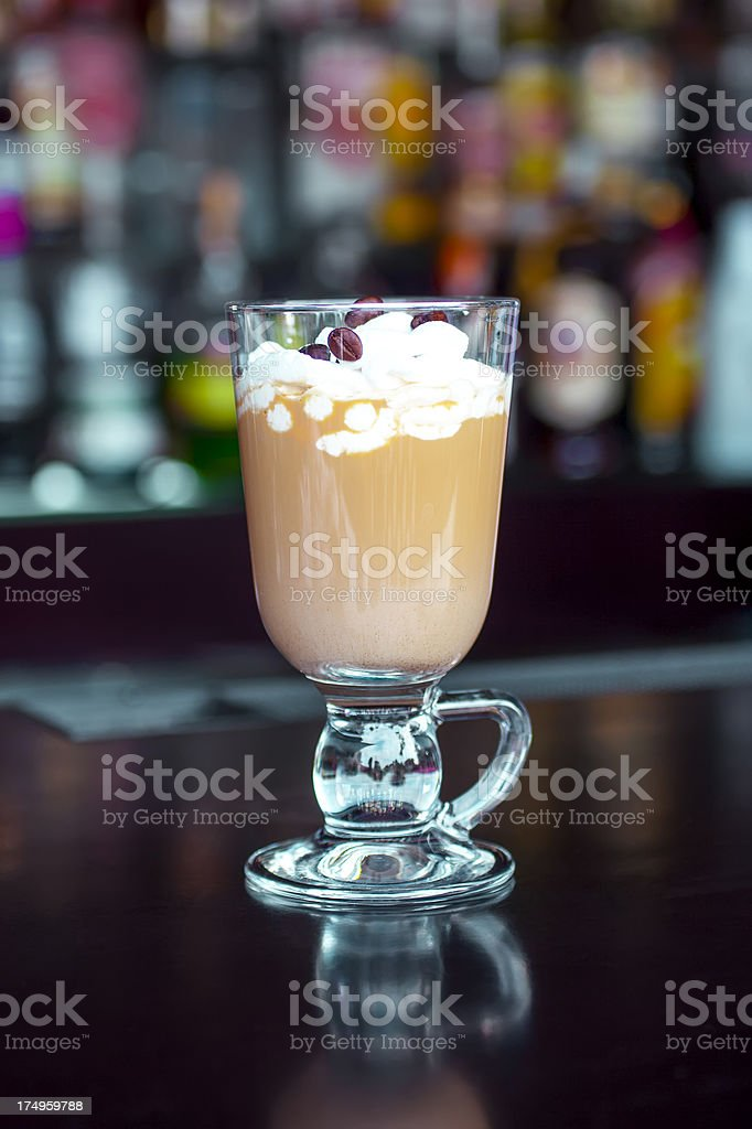Classic Irish Coffee hot cocktail on the black bar table stock photo