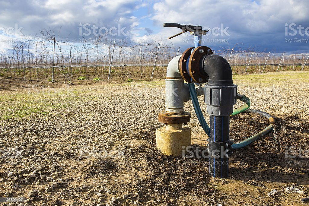 Classic irrigator for fields in countryside stock photo