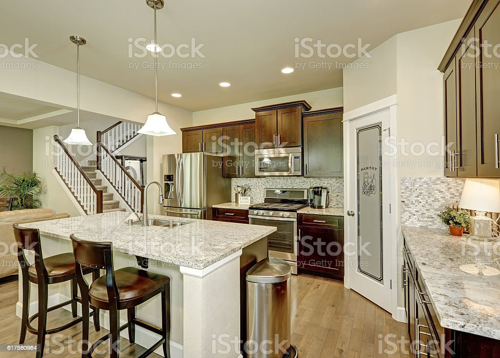Classic kitchen room interior with large kitchen island stock photo