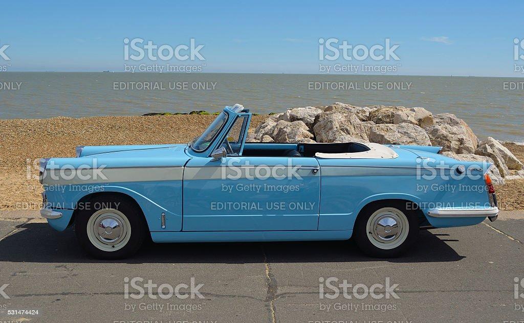 Classic light Blue Triumph Herald open top motor car stock photo