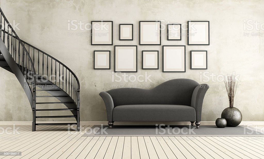 Classic living room with circular staircase stock photo
