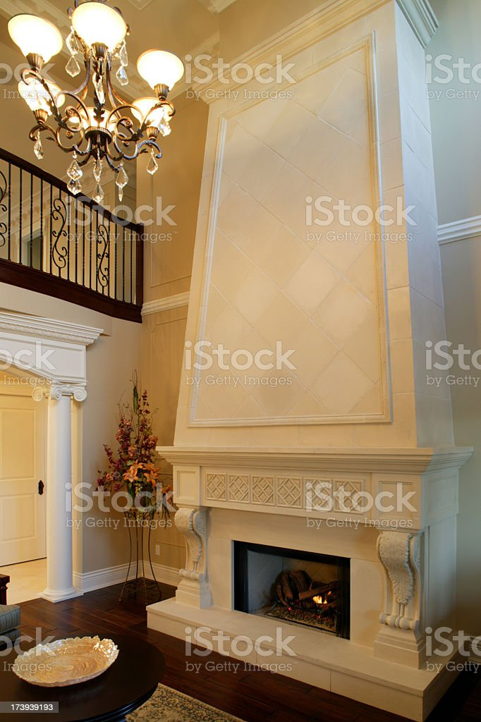 Classic luxurious white fireplace in an estate living room royalty-free stock photo