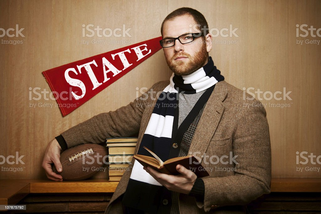 Classic Male college student with book and ball royalty-free stock photo