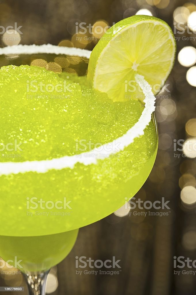 Classic margarita cocktail in front of different colored backgrounds stock photo