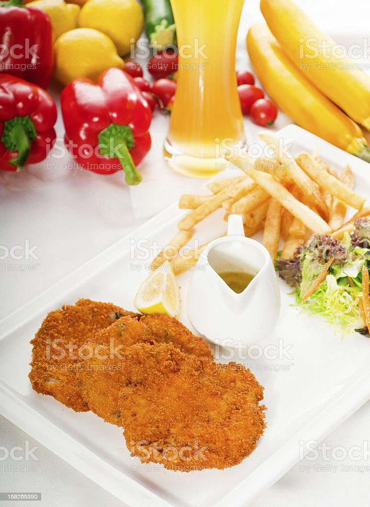 classic Milanese veal cutlets and vegetables royalty-free stock photo