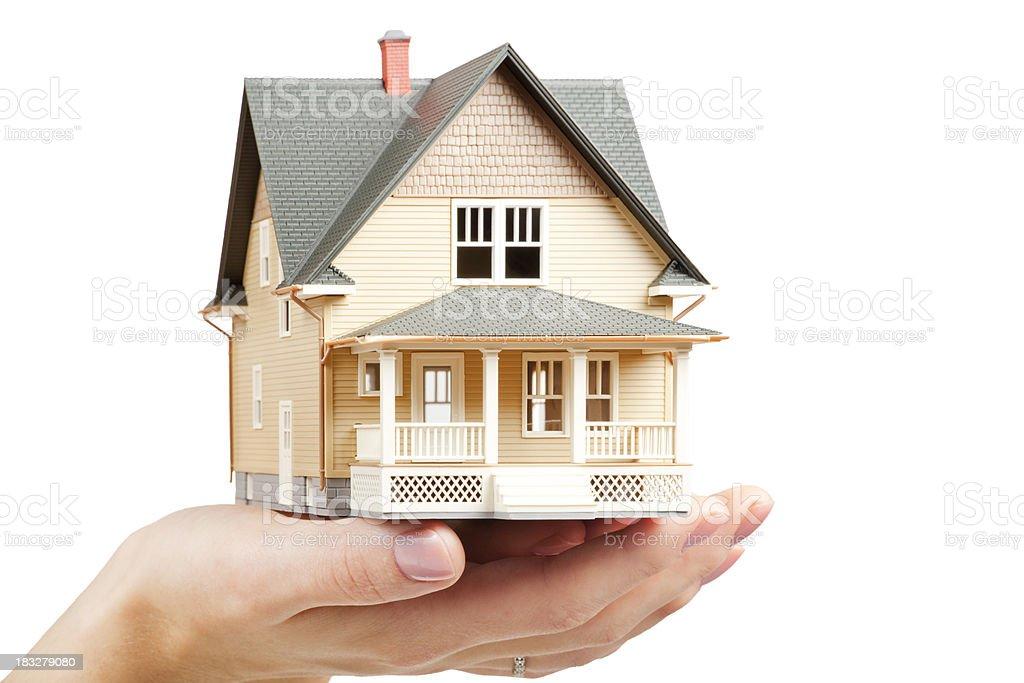 Classic miniture model home held in female hand stock photo