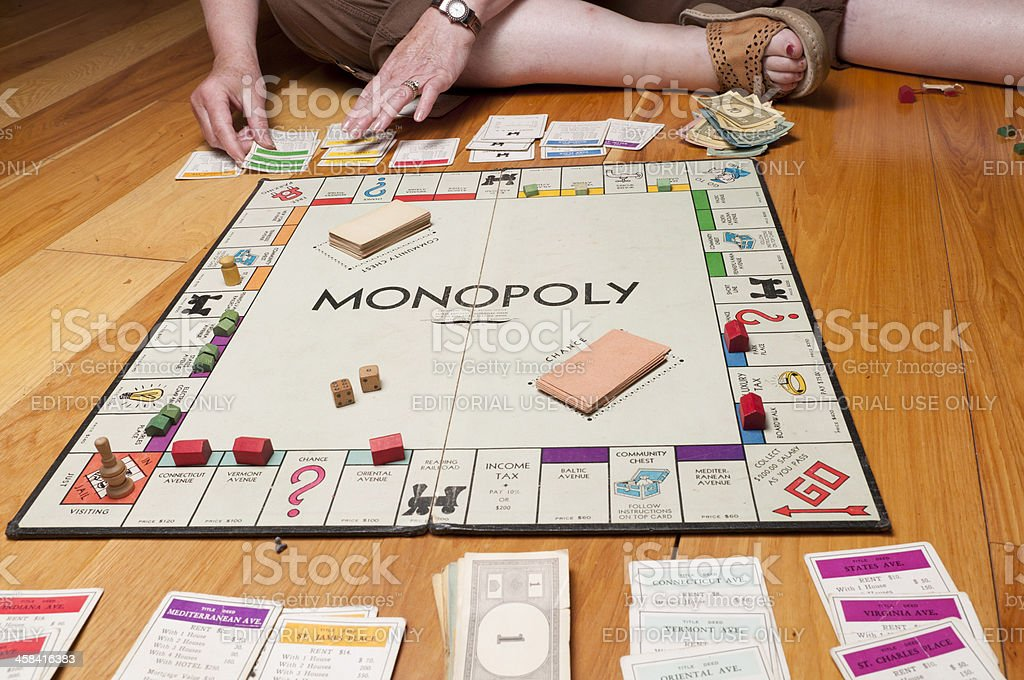 Classic Monopoly Game on the Floor Midgame royalty-free stock photo