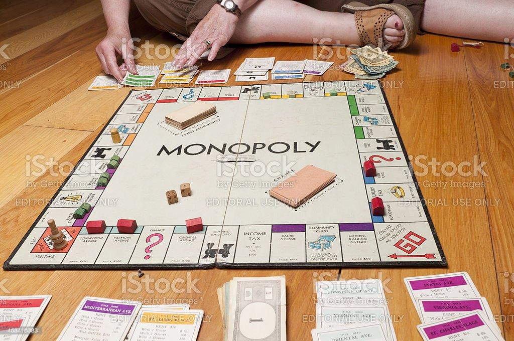 Classic Monopoly Game on the Floor Midgame stock photo