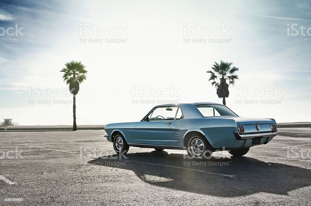 Classic Muscle Car on a parking close to a beach stock photo