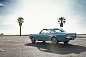 Classic Muscle Car on a parking close to a beach