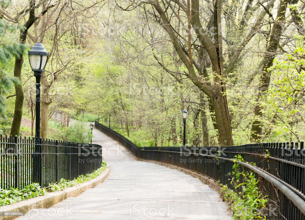 Classic NYC Riverside Park Tree Lined Steps with Lamposts stock photo