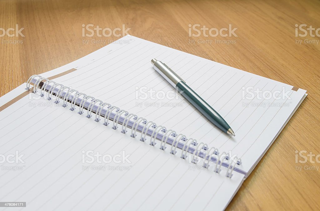 Classic pen and notebook on wooden desk royalty-free stock photo