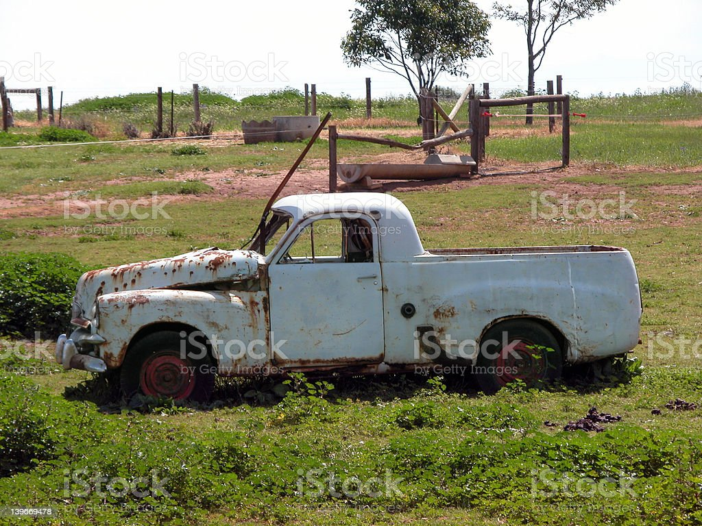 Classic pick up rusting in a paddock stock photo