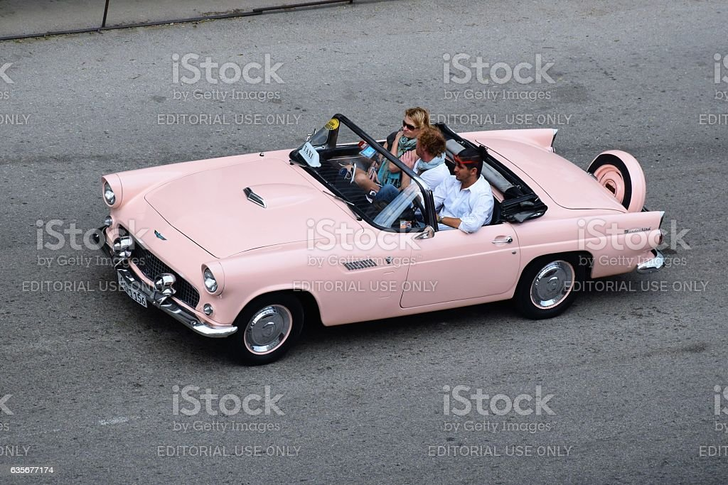 Classic pink cabriolet driving on the street in Havana stock photo