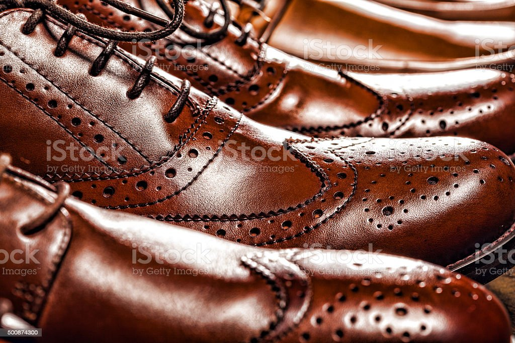 Classic polished men's brown oxford brogues stock photo