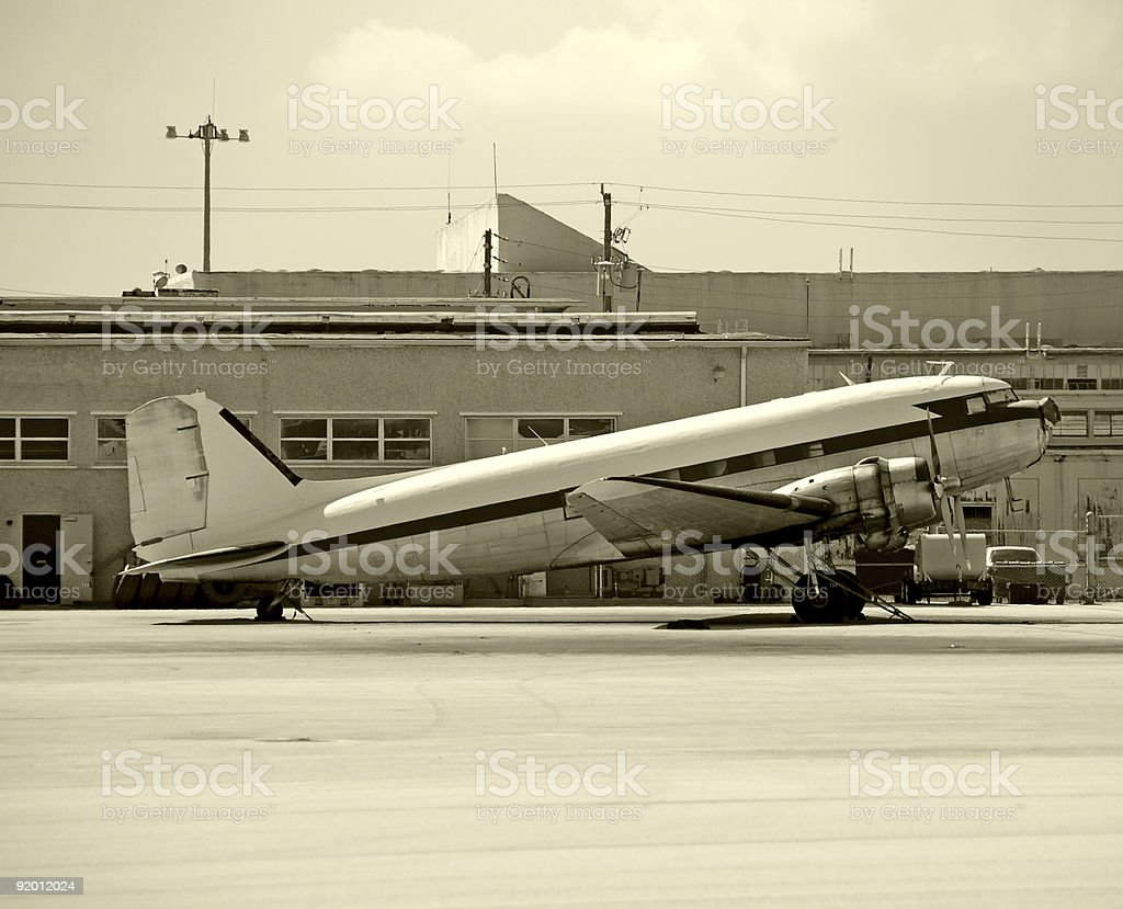 Classic propeller airplane on the ground stock photo