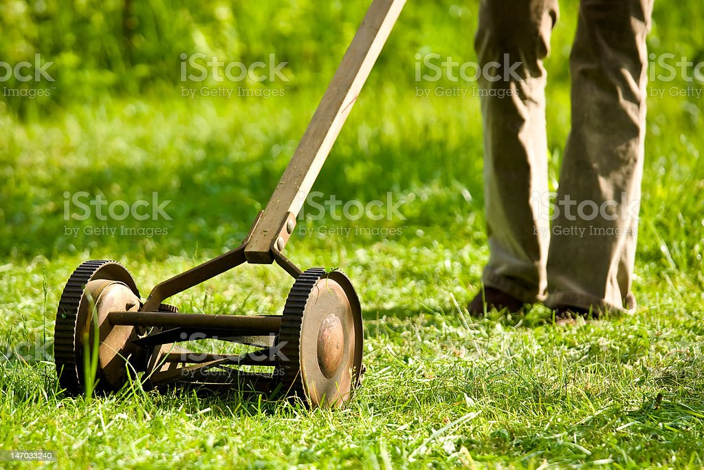 A classic push mower with legs stock photo
