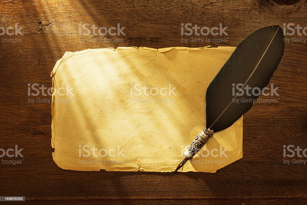 Classic quill pen on blank letter paper royalty-free stock photo