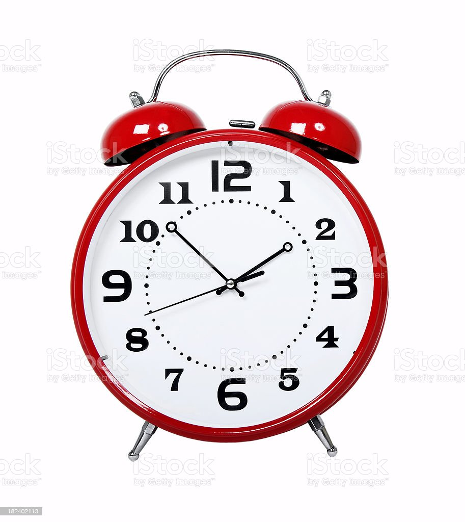A classic, red alarm clock showing a time of 1:52 stock photo